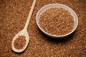 picture of buckwheat  - buckwheat groats and wooden spoon next to bowl - JPG