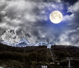 picture of olympiade  - Panoramas of mountains mountain ski lifts at Krasnaya Polyana in the light of the full moon Sochi Russia - JPG