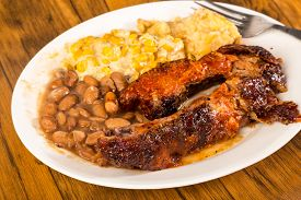 image of jalapeno  - BBQ rib plate with jalapeno corn and borracho beans and tater tot casserole on rustic wooden boards - JPG