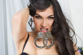 image of handcuff  - Woman in underwear - JPG