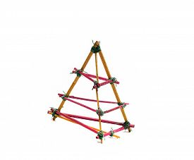 foto of triangular pyramids  - interesting pyramid of wooden chopsticks on a white background  - JPG