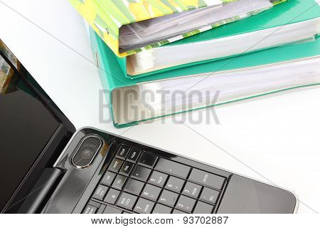 Laptop And File Folders On White Background