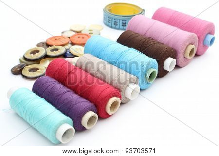 Colorful Spools Of Thread, Tape Measure And Buttons
