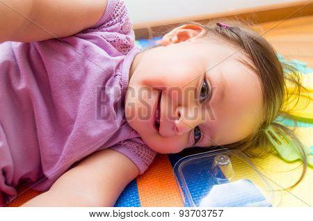 Adorable baby girl lying sideways