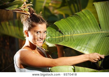 Young Girl And A Palm Tree Leaf
