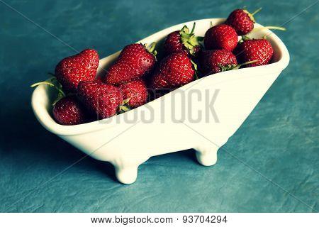 Strawberries in minature bathtubs