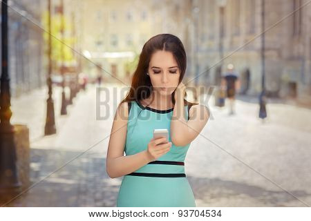 Curious Girl Looking at Her Phone