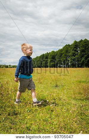 Little boy in a field of tall grass