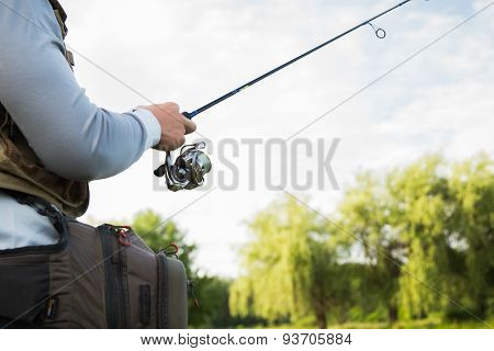 Fisherman on the river bank.