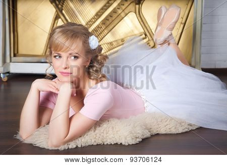 Ballerina With Flower In Her Hair Lying On The Floor