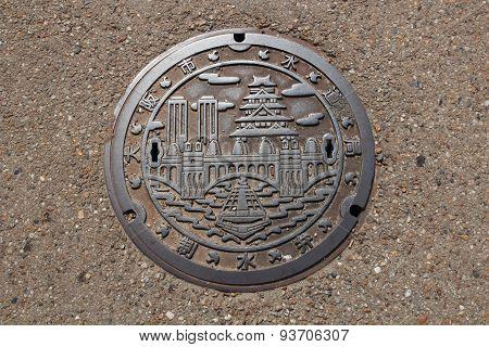 Artistic manhole cover at Osaka Castle, Japan
