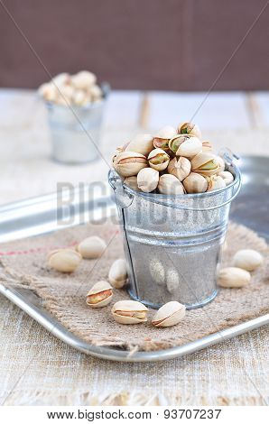 Pistachio nuts in a bucket