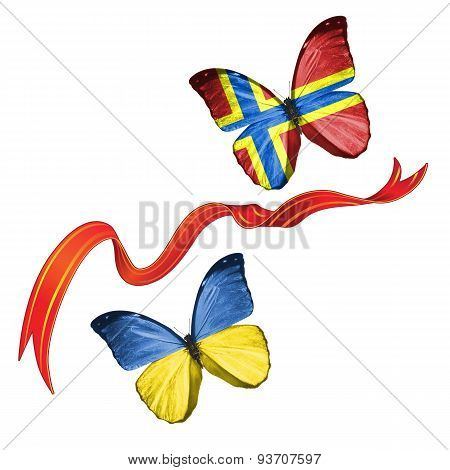 Two butterflies with symbols of Ukraine and Orkney Islands