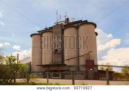 Old industrial silos under blue sky