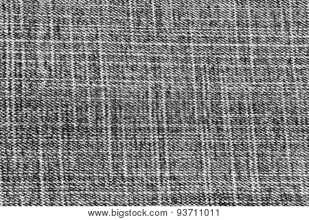Closeup detail of black jeans fabric background