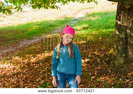 Autumn portrait of a cute little girl in the park