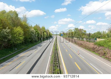 Empty highway in front of blue sky