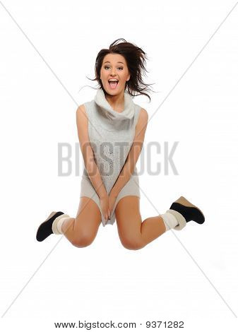 Expressions - Beautiful Funny Winter Woman Jumping And Screaming. Isolated On White Background