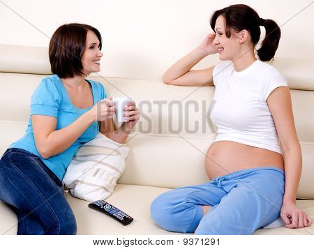 Pregnant Woman Communicates With The Girlfriend