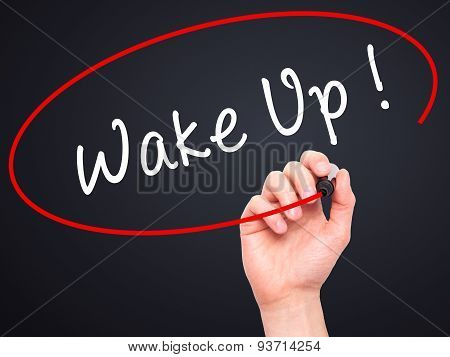 Man Hand writing Wake Up with black marker on visual screen.