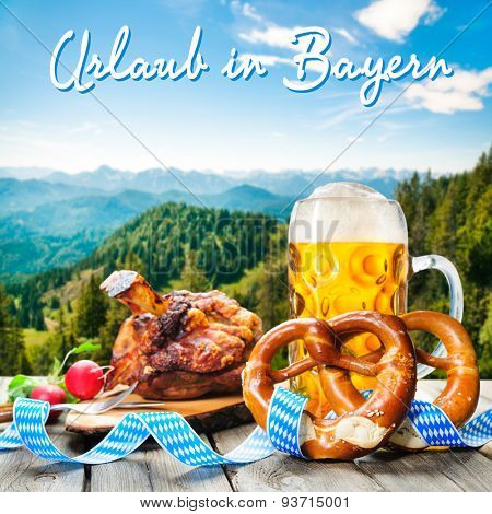 Roasted pork knuckle with pretzels and beer. Background with German text Holidays in Bavaria