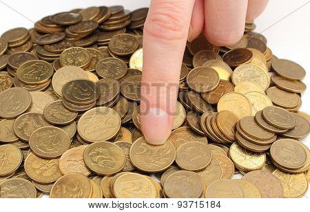 Heap Of Old Coins And Finger Of Woman