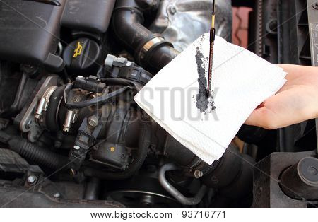 Auto Mechanic Checks The Oil Level