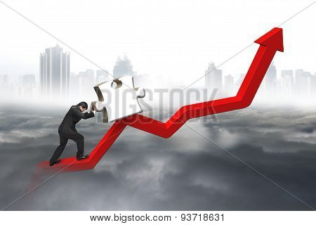 Business Man Pushing 3D Jigsaw Puzzle Upward Red Trend Line
