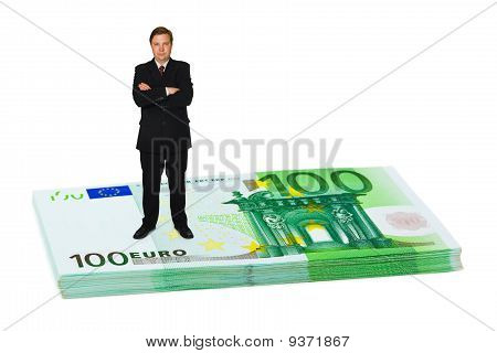 Businessman On Money