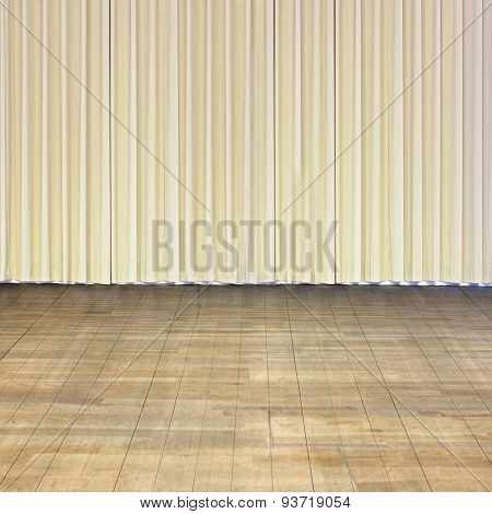 Indoor Stage With Old Wood Floor And Beige Curtain