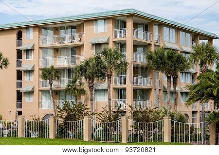 Palm Trees Around Tropical Stucco Condos