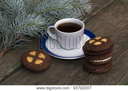 Coffee And Cookies With A Coniferous Branch