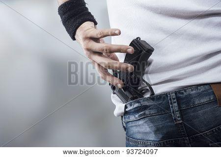 Man Grabbing His Pistol
