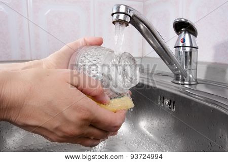 Women's Hands Washing The Dishes