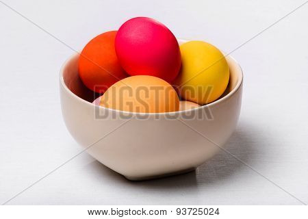 Easter Eggs In A Bowl On The White Cloth