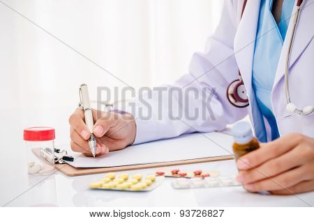 doctor writing medical record