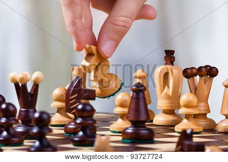 The Hand Of Chess Player With Knight