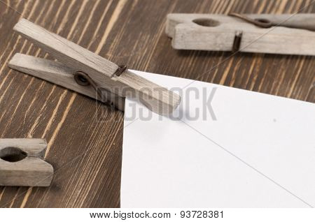Old Wooden Clothes Pins And Blank Paper