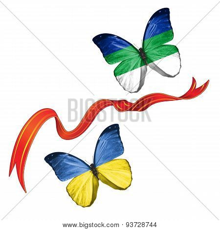 Two butterflies with symbols of Ukraine and Komi (Russia)