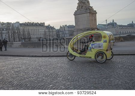 Paris, France January 1, 2015: Ecological tricycle taxi service, in Paris, France