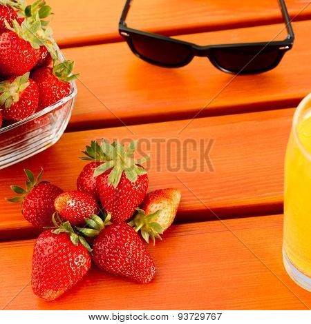 Strawberry With Sunglass And Juice