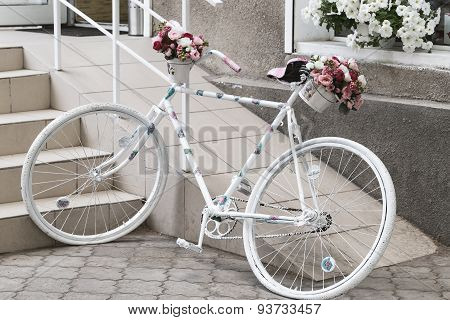 Creative Bouquet Of Colorful Artificial Flowers On Old White Bicycle, Retro. Selective Focus And Spa