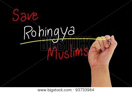 Hand With Pen Writing Save Rohingya Muslims From Human Trafficking Isolated On Black Background