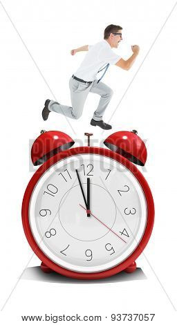 Geeky happy businessman running mid air against alarm clock counting down to twelve