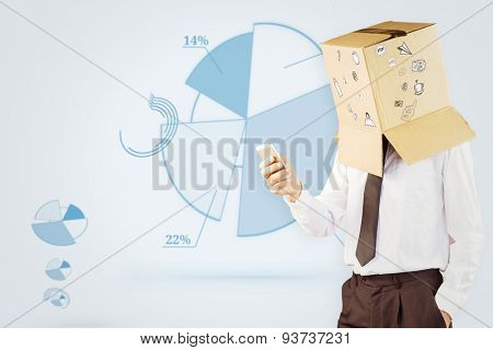 Anonymous businessman with his smartphone against blue pie chart graphic