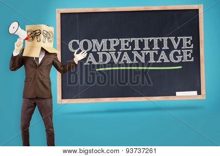 Anonymous businessman holding a megaphone against competitive advantage written on a chalkboard