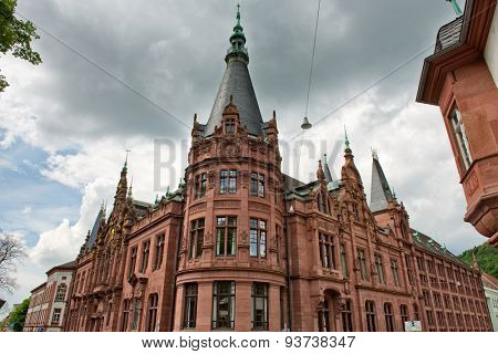 Architectural Exterior of Corner Tower of Heidelberg University Library Underneath Grey Rain Clouds, Baden-Wurttemberg, Germany
