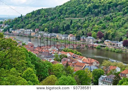 Overview of Old Bridge Spanning Neckar River from New to Old Neighborhoods of Heidelberg, in Green Hillsides of Baden-Wurttemberg, Germany