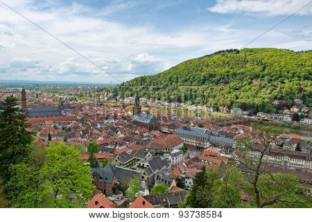 Overview of Old Bridge Spanning Neckar River Between Old and New Towns of Heidelberg in Green Hills of Baden-Wurttemberg, Germany