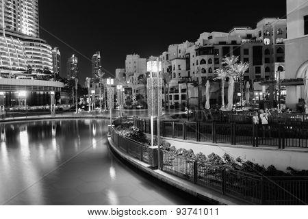 DUBAI - OCTOBER 15, 2014: area near the Dubai Fountain. The Dubai Fountain is the world's largest choreographed fountain system set on the 30-acre manmade Burj Khalifa Lake.